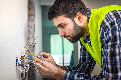An electrician working in a residence